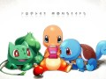 Gen 1 starter Pokemon playing on a Game Boy